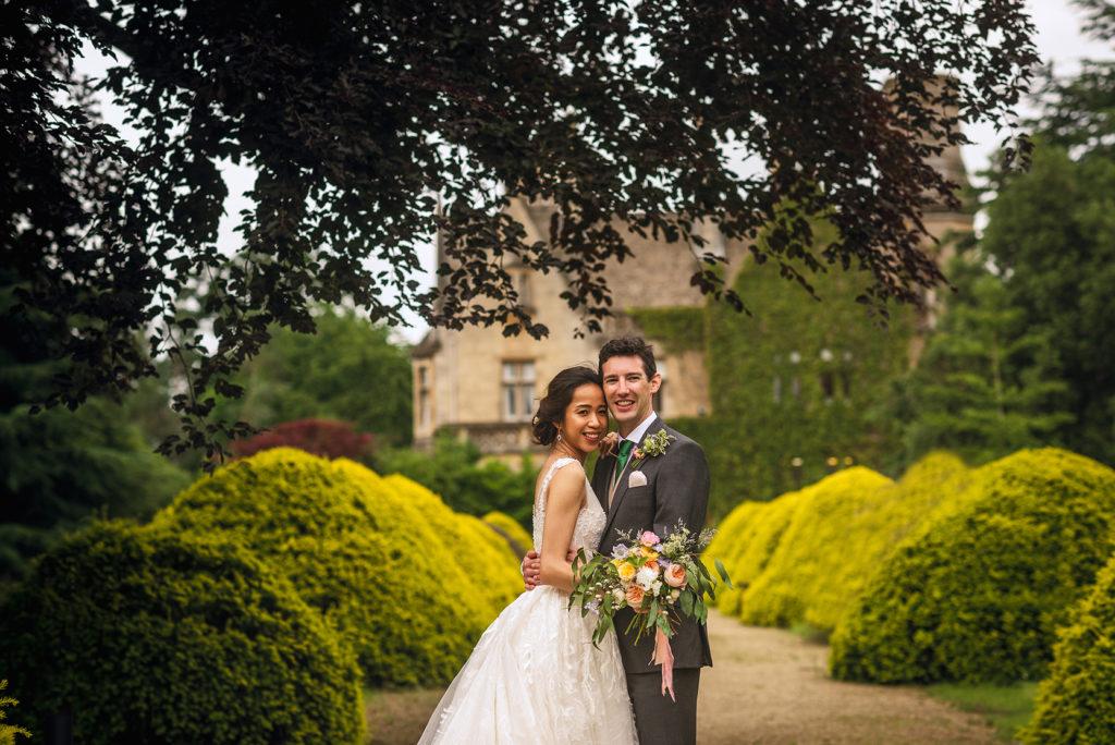 Summer Weddings at Manor By The Lake Yew tree walk 3